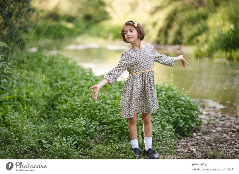 Little beautiful girl in nature stream Woman Child Human being Nature Summer Beautiful Flower Joy Girl Adults Lifestyle Meadow Feminine Grass Small Happy