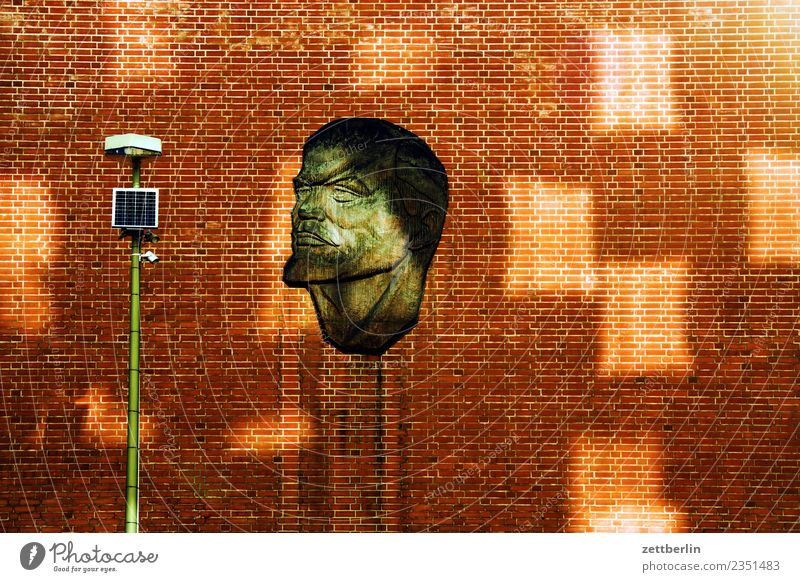 Lenin House (Residential Structure) Wall (building) Facade Wall (barrier) Brick Building Art Portrait photograph Face Soviet Union Light Patch of light Lantern