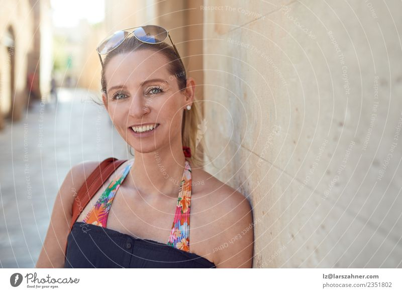 Attractive stylish woman relaxing against a wall Style Happy Face Relaxation Vacation & Travel Tourism Summer Woman Adults 1 Human being 45 - 60 years Warmth