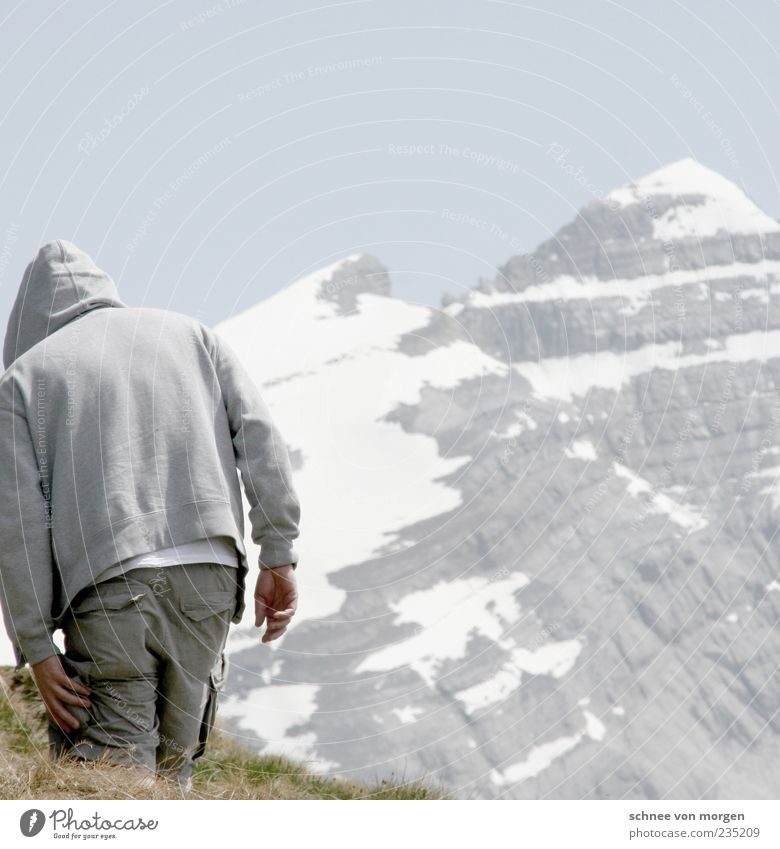 Human being Sky Man Blue Vacation & Travel Adults Mountain Snow Grass Gray Stone Back Masculine Hiking Switzerland Pants