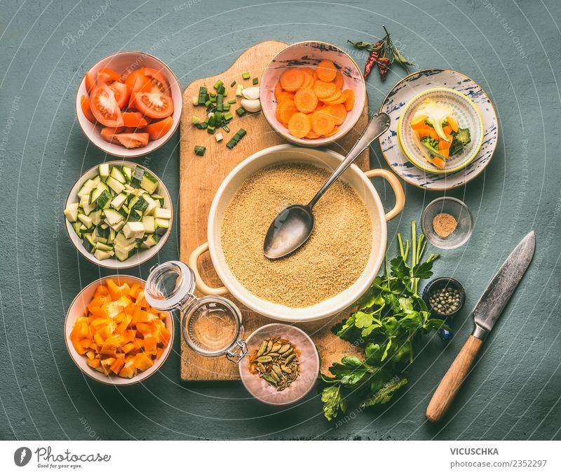 Vegetarian diet with couscous and vegetables Food Vegetable Grain Herbs and spices Nutrition Lunch Dinner Organic produce Diet Crockery Plate Knives Spoon Style