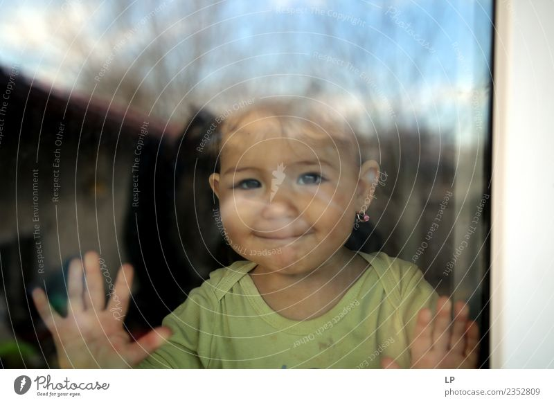 beautiful baby smiling and watching through a window Lifestyle Joy Playing Children's game Parenting Education Kindergarten Human being Baby Parents Adults