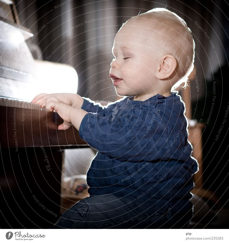 pianissimo Playing Make music Piano Play piano Music Human being Masculine Baby Toddler Face Ear Mouth Hand Fingers 1 - 3 years Sit Joy Happiness Education