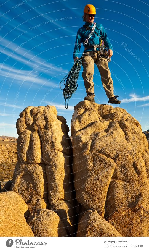 Rock climber on the summit. Human being Man Adults Mountain Freedom Tall Hiking Adventure Success Climbing Peak Brave Athletic Balance Top Mountaineering