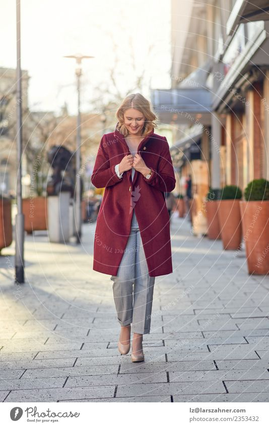 Woman in red coat walking alone in the city Elegant Style Happy Beautiful Office Business Adults 1 Human being 18 - 30 years Youth (Young adults) Autumn Street