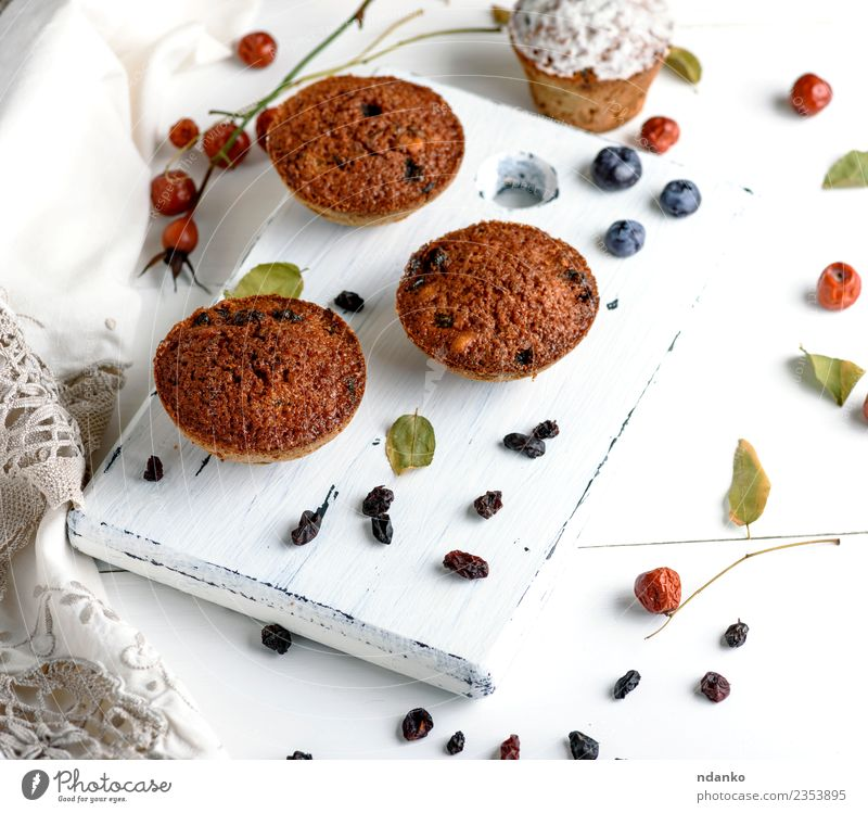 cupcakes with dried fruits Cake Dessert Nutrition Breakfast Table Wood Eating Fresh Small Above Brown White background Baking Bakery chocolate cooking Cupcake