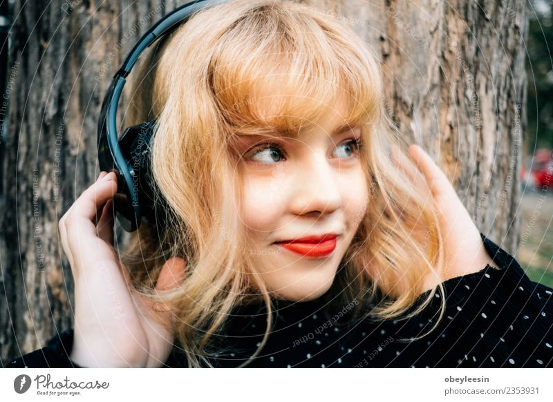 Young pretty girl having fun listening to music in headphones, Lifestyle Style Joy Happy Beautiful Relaxation Leisure and hobbies Summer Music Telephone