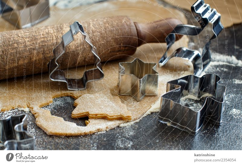 cooking christmas cookies with cookie cutters on a dark table a royalty free stock photo from photocase - Metal Christmas Cookie Cutters