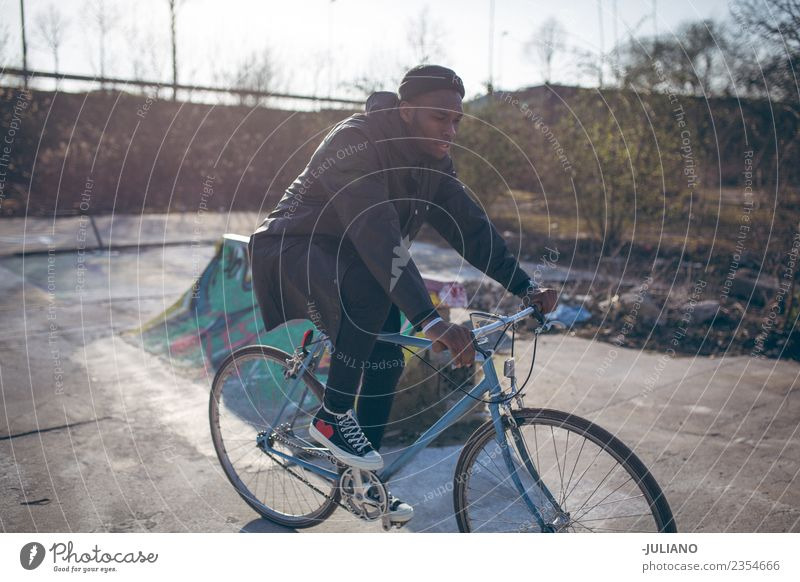 Young man is riding his bike on urban skatepark Lifestyle Leisure and hobbies Vacation & Travel Trip Human being Masculine Youth (Young adults) 13 - 18 years