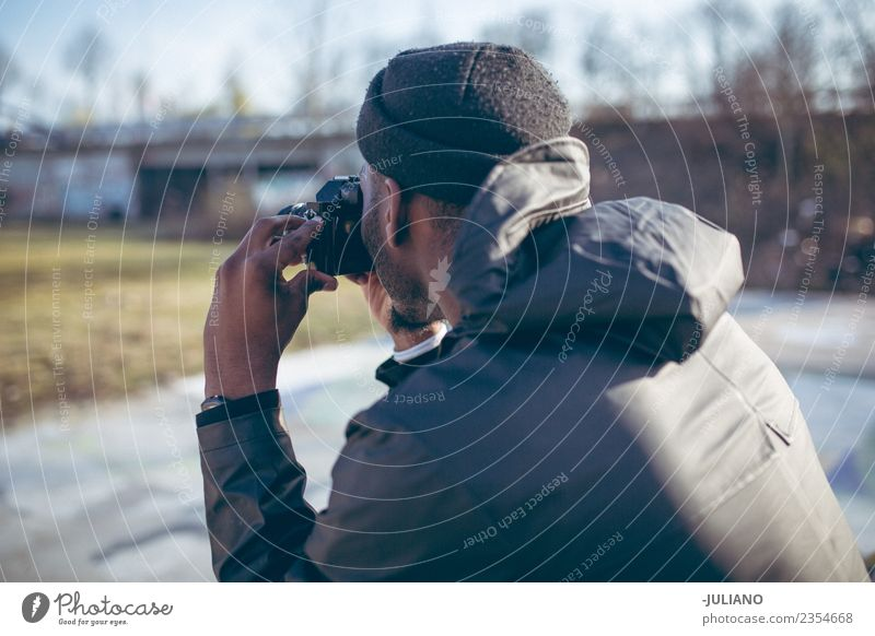 Young man is taking a picture with his camera Human being Vacation & Travel Youth (Young adults) Town 18 - 30 years Adults Lifestyle Think Trip