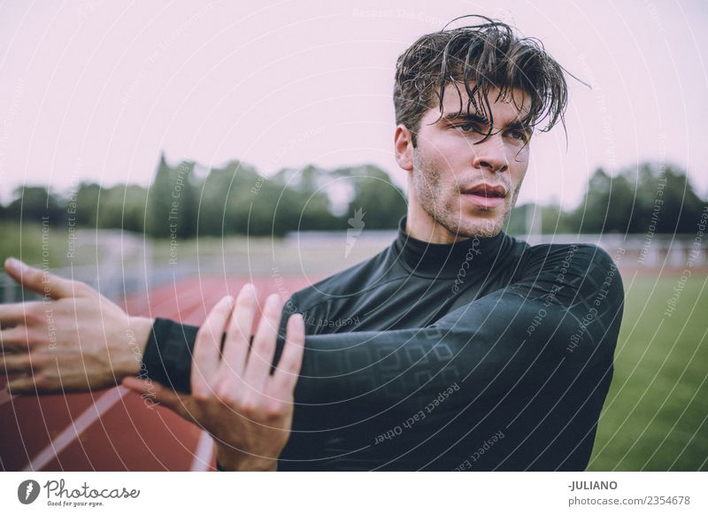 Young sports man is doing stretching at running track Drinking water Lifestyle Joy Body Healthy Healthy Eating Health care Athletic Muscular Fitness Well-being
