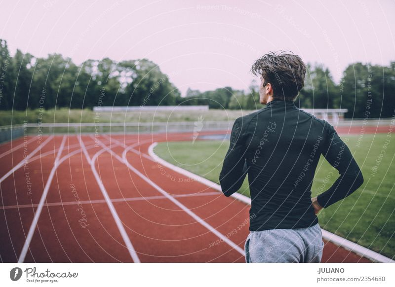 Young sports man exercising at running track Drinking water Lifestyle Joy Body Healthy Healthy Eating Health care Athletic Muscular Fitness Well-being