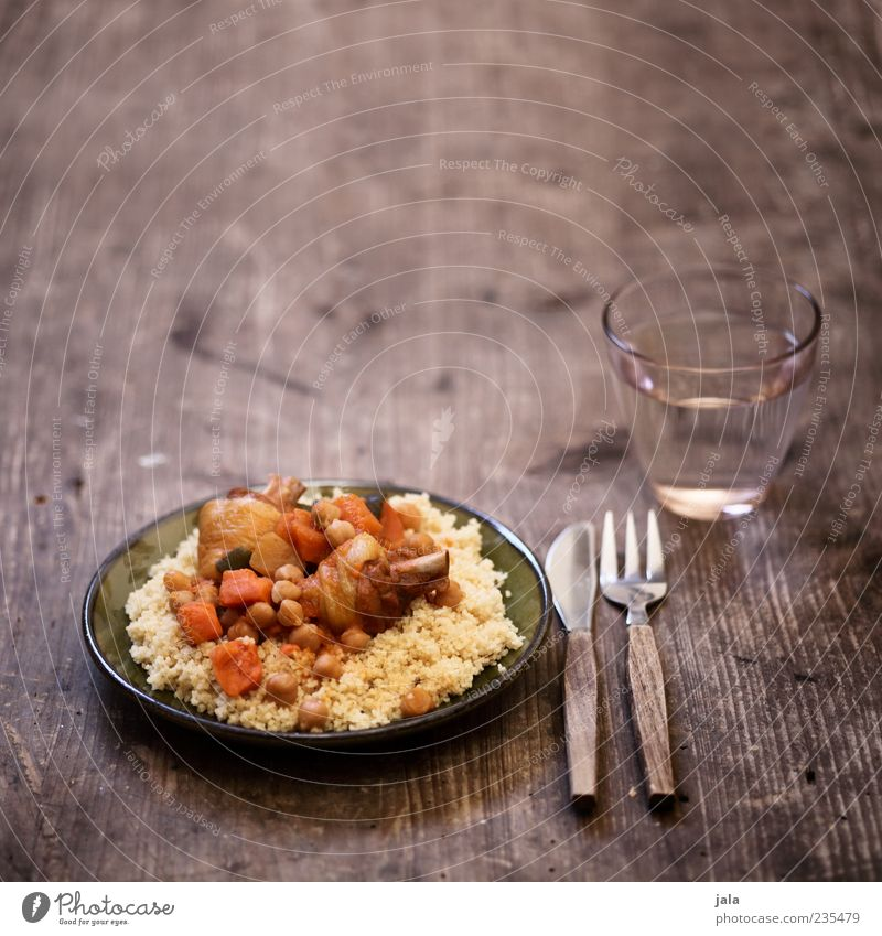 couscous royal Food Meat Vegetable Poultry Nutrition Lunch Beverage Drinking water Crockery Plate Glass Cutlery Knives Fork Delicious Appetite Wooden table