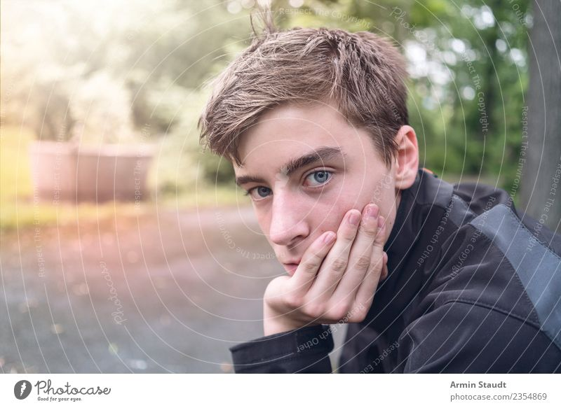 Thoughtful Lifestyle Senses Calm Human being Masculine Young man Youth (Young adults) Hand 1 Nature Park Sit Emotions Moody Patient Boredom Sadness Loneliness