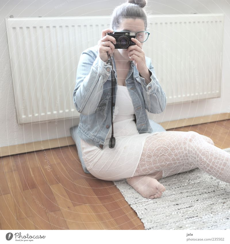 Human being Woman White Adults Feminine Hair and hairstyles Bright Room Sit Soft Camera Heater Photographer Take a photo Parquet floor Crouch