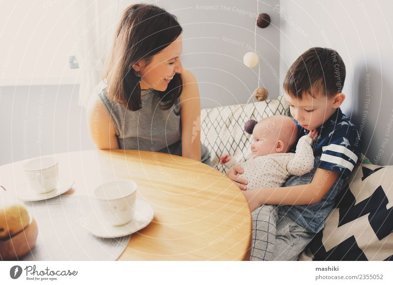 happy family in kitchen Human being Child Baby Boy (child) Woman Adults Parents Mother Brothers and sisters Family & Relations Happiness Kitchen Breakfast Joy