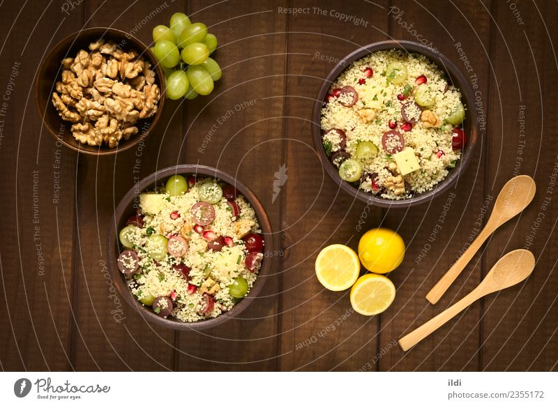 Couscous with Grapes, Pomegranate, Nuts and Cheese Dish Fruit Fresh Grain Dinner Meal Vegetarian diet Lunch Salad Lemon Horizontal Rustic Raw Snack Mint
