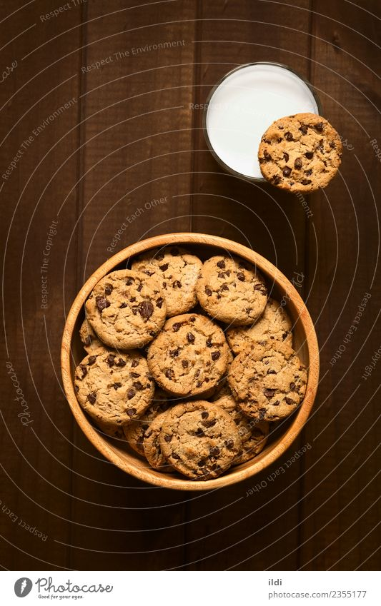 Chocolate Chip Cookies with Milk Dairy Products Dessert Candy Breakfast Natural chocolate cookie biscuit food Snack sweet Baking glass cold drink Rustic wood