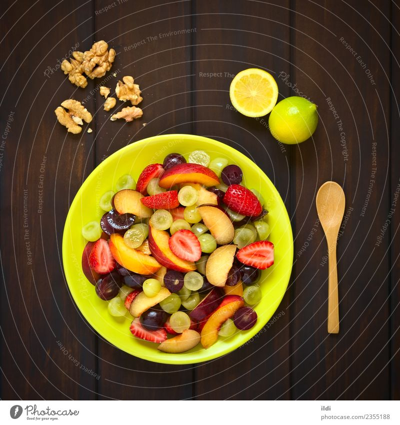 Fresh Fruit Salad Food Dessert Nutrition Breakfast Raw Plum Nectarine Strawberry colorful healthy Snack Vitamin Lemon nut walnut Variety wood overhead quadratic