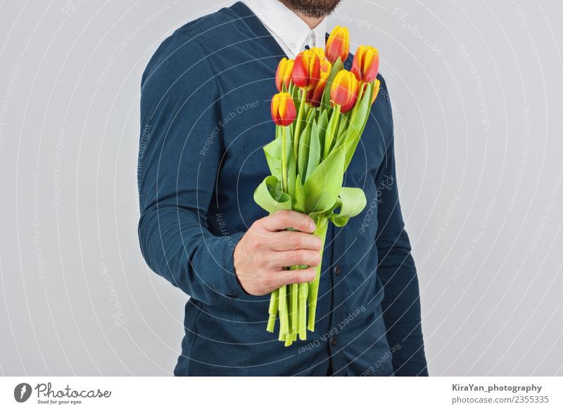Man with a beard holding bouquet of tulips Human being Blue Beautiful White Hand Flower Red Adults Yellow Love Happy Feasts & Celebrations Copy Space Gift