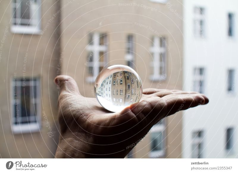 Glass ball + facade Hand Fingers To hold on Indicate Sphere Reflection Rent Tenant Old building Facade Window House (Residential Structure) Apartment house