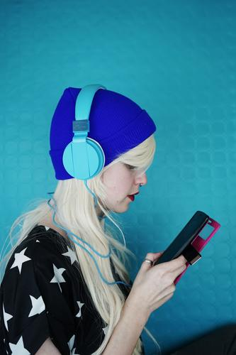 Young woman listening to music with her headphones and phone Human being Youth (Young adults) Blue 18 - 30 years Adults Life Lifestyle Feminine Style Art