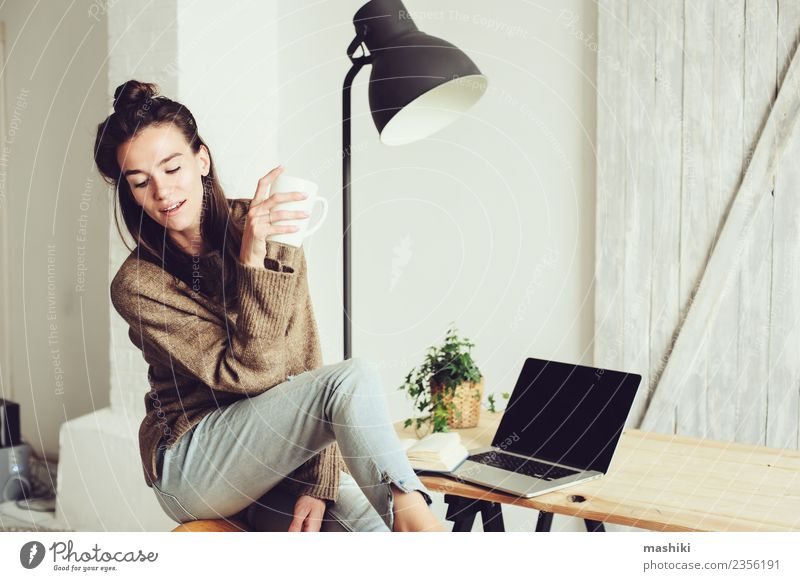 young beautiful woman at home Woman Relaxation Joy Adults Lifestyle Modern Technology Sit Action Computer Coffee Telephone Internet Home Notebook Cozy