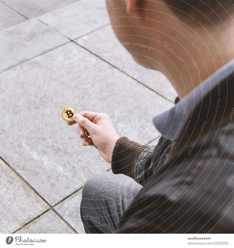 young man holds Bitcoin coin in his hand Human being Masculine Young man Youth (Young adults) Man Adults 1 18 - 30 years Money Financial Industry Cryptocurrency