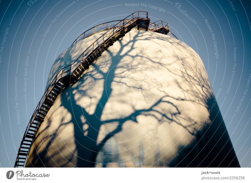 time to refuel Energy industry Tank Cloudless sky Winter Beautiful weather Stairs Warmth Moody Surrealism Change Time Shadow play Illusion Vignetting Abstract