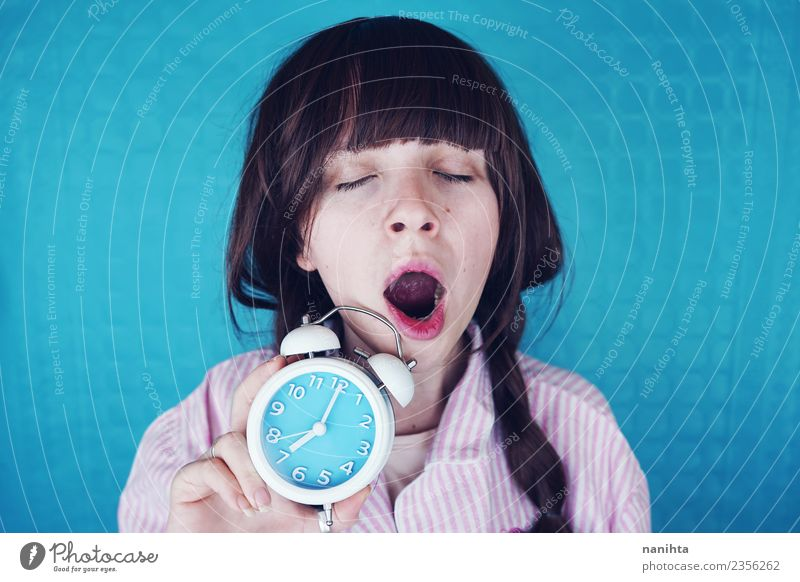 Young woman yawning and holding a clock at morning Lifestyle Style Healthy Human being Feminine Youth (Young adults) 1 18 - 30 years Adults Night dress