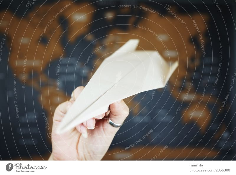 Paper airplane against a map background Design Exotic Leisure and hobbies Playing Vacation & Travel Tourism Trip Adventure Far-off places Freedom Transport