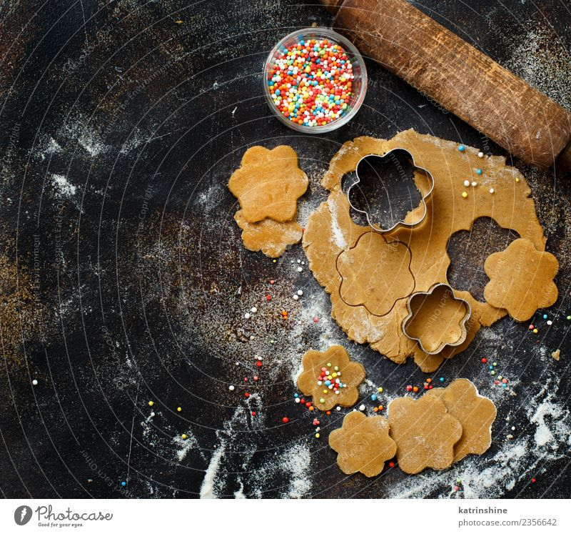 Cooking cookies with cookie cutters on a dark table Dough Baked goods Dessert Kitchen Flower Metal Make Above Brown Tradition Baking Bakery biscuit cooking