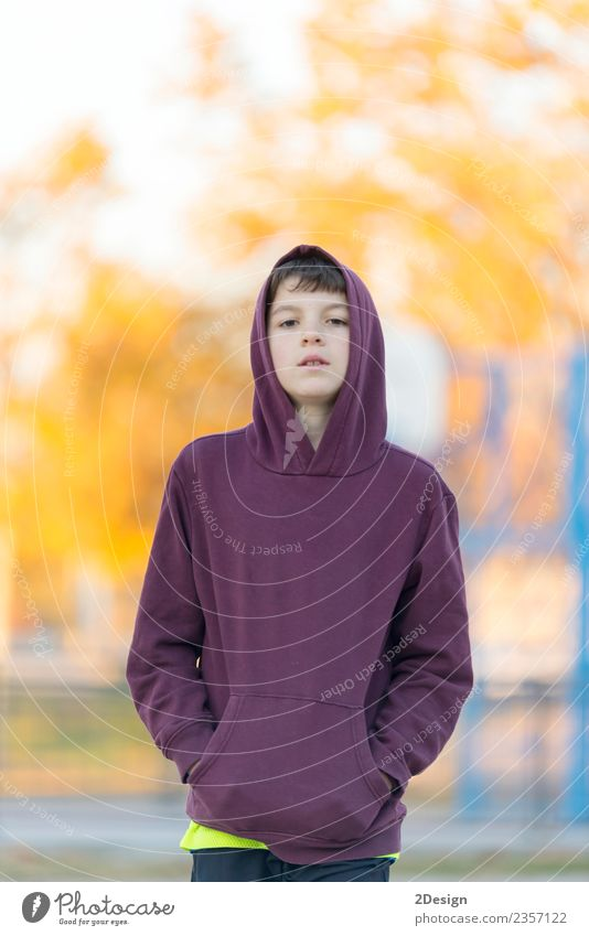 Teen boy in hood over park nature background. Lifestyle Beautiful Face Child Human being Masculine Boy (child) Man Adults Infancy 1 8 - 13 years Nature Autumn