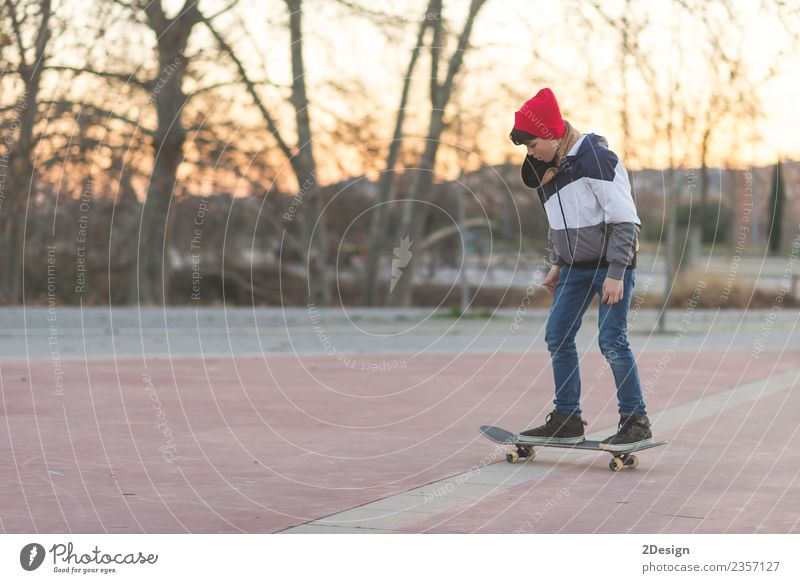 Kid skateboarder doing a skateboard trick. Child Human being Nature Youth (Young adults) Man Summer White Adults Street Lifestyle Sports Style Boy (child) Happy
