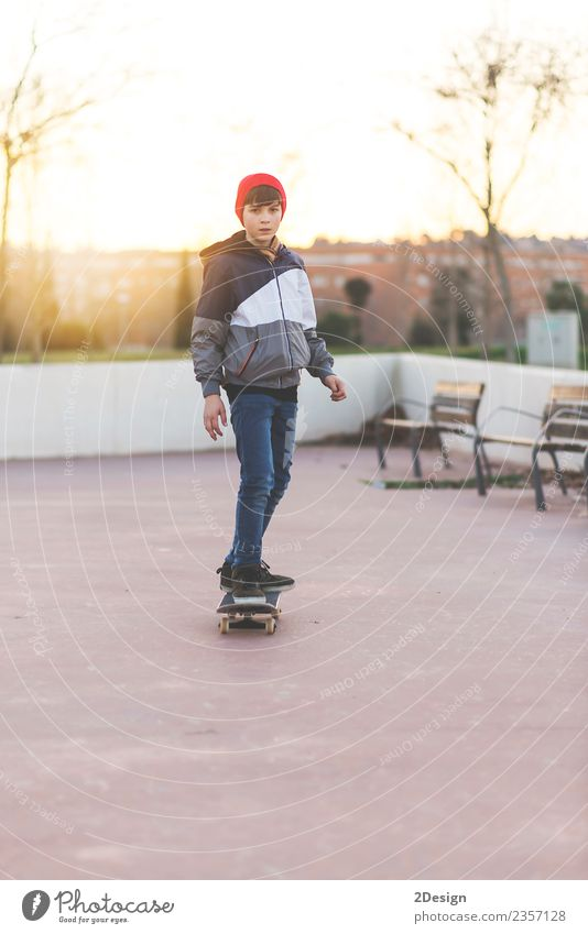 Kid skateboarder doing a skateboard trick. Lifestyle Style Happy Leisure and hobbies Summer Sports Human being Masculine Boy (child) Man Adults
