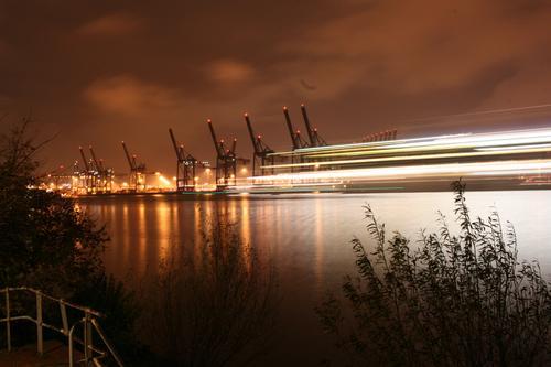harbour lights Workplace Economy Logistics Crane Summer River bank Elbe Hamburg Port City Inland navigation Harbour Far-off places Gigantic Large Town Moody