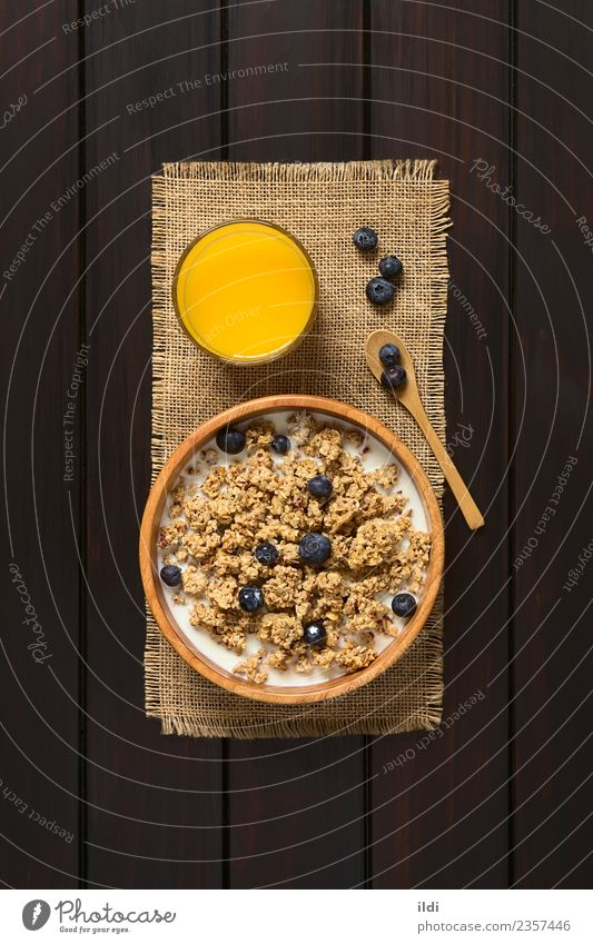 Breakfast Cereal with Blueberries and Milk Fruit Juice Dark Natural food oatmeal Blueberry dry sweet sweetened healthy Meal Snack milk glass Rustic fiber Dairy
