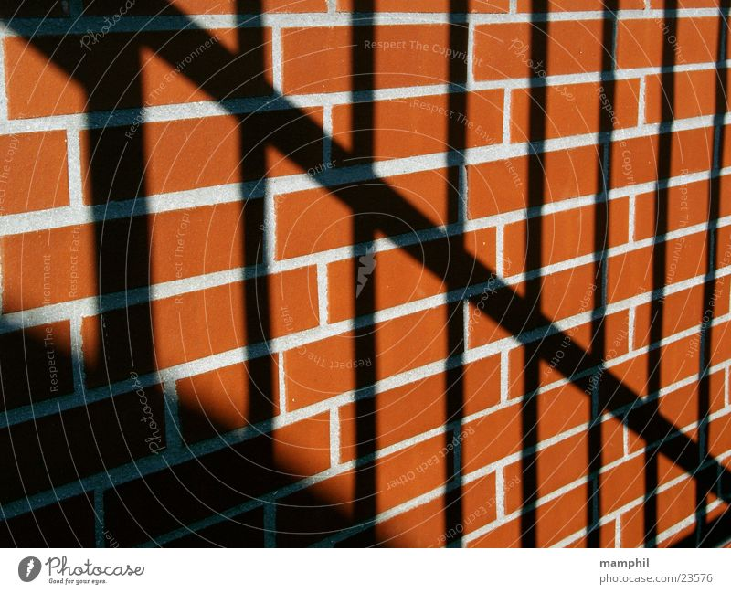 bars and bricks Wall (barrier) Brick Brick red Red Grating Architecture Stone Seam Shadow X