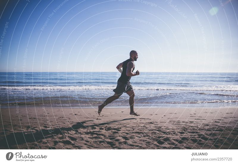 sports man doing quick run at the beach Young man Sports workout Beach Fitness Sports Training Hard Perspire Musculature Joy Sportsperson Speed Positive Healthy