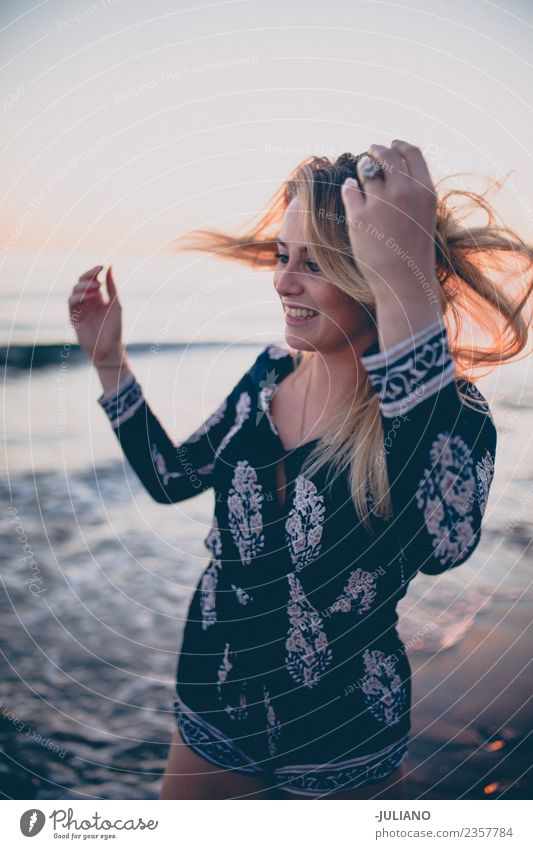 Young woman at the beach while the sunset smiling Vacation & Travel Summer Sun Ocean Joy Girl Beach Lifestyle Laughter Sand Retro Blonde Smiling Cool (slang)