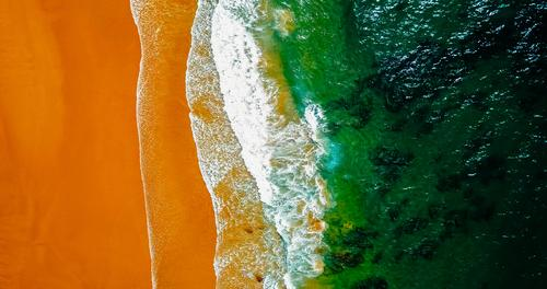 Aerial Drone View Of Ocean Waves And Beautiful Beach in Portugal Nature Summer Green Water Landscape Warmth Environment Coast Brown Orange Sand Weather