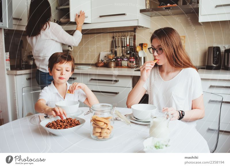 happy family having breakfast at home Child Youth (Young adults) Joy Adults Life Lifestyle Family & Relations Happy Together Happiness Smiling Kitchen Mother