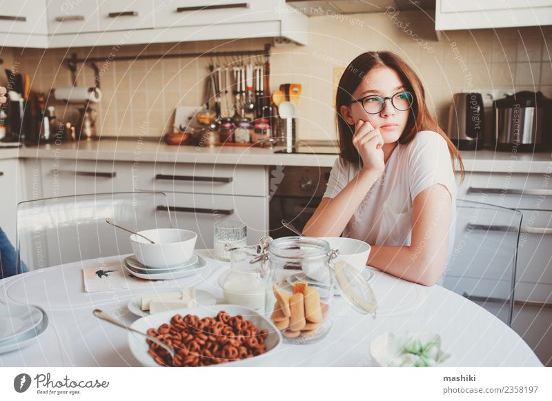 teen girl having breakfast Breakfast Lifestyle Joy Happy Kitchen Child Sister Youth (Young adults) Smiling Embrace Together Modern White Relationship