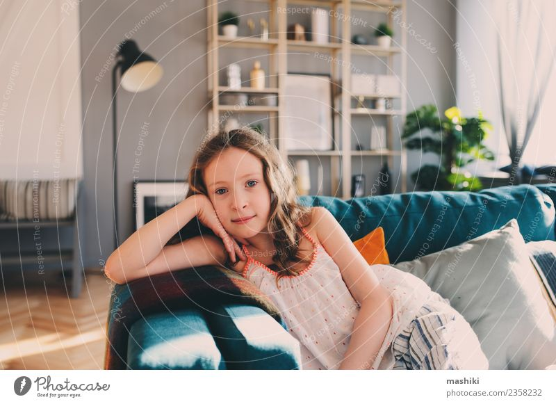 cute kid girl relaxing at home Lifestyle Joy Happy Relaxation Leisure and hobbies Playing Flat (apartment) Child Infancy Smiling Comfortable Home young Rest