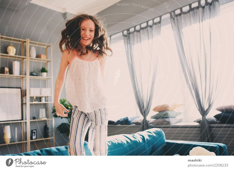 happy kid girl playing at home Lifestyle Joy Relaxation Playing Flat (apartment) Child Family & Relations Infancy Jump Crazy Comfortable Home young Playful time