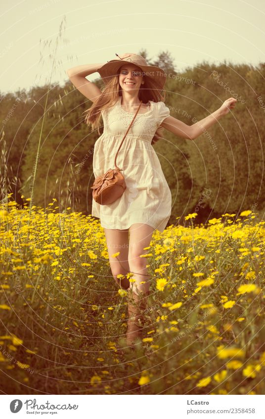Young smiling woman jumping in a field of daisies Human being Nature Vacation & Travel Youth (Young adults) Young woman Beautiful Flower Joy 18 - 30 years