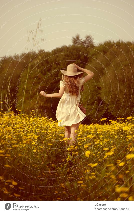 Young woman running in a field of daisies Lifestyle Joy Vacation & Travel Freedom Human being Feminine Youth (Young adults) 1 13 - 18 years 18 - 30 years Adults