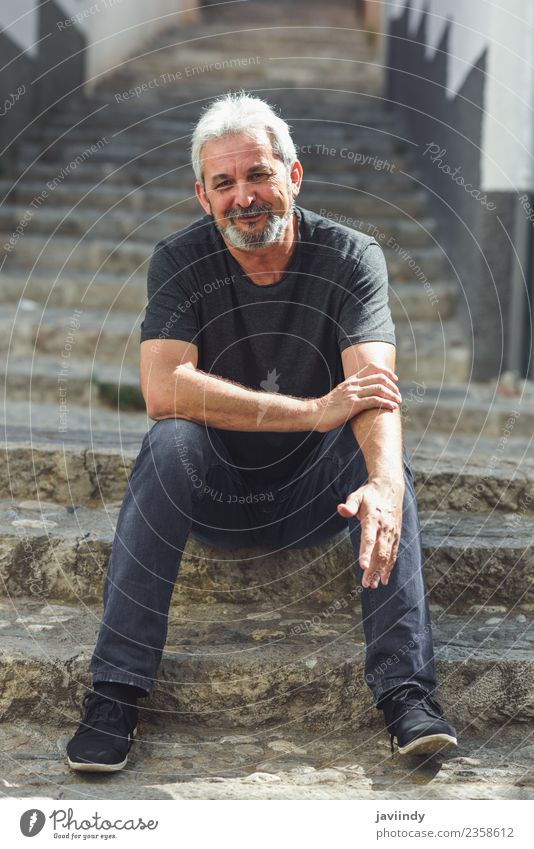 Mature man sitting on steps on steps smiling. Human being Man Old White Adults Street Lifestyle Senior citizen Happy 45 - 60 years 60 years and older Smiling
