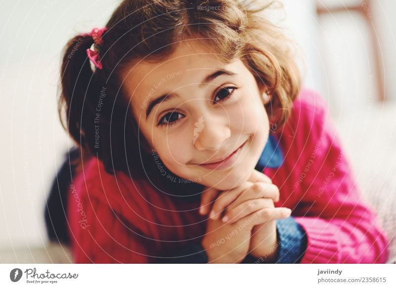 Adorable little girl with sweet smile lying down on bed. Joy Happy Beautiful Face Child Human being Girl Woman Adults Infancy 1 3 - 8 years Smiling Small Cute