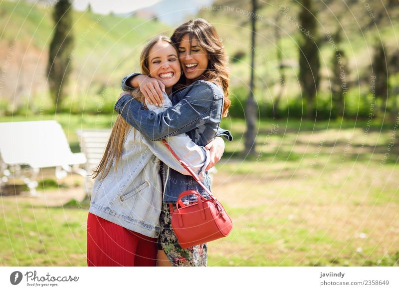 Two happy girls hugging in urban park. Lifestyle Joy Happy Beautiful Human being Young woman Youth (Young adults) Woman Adults Friendship 2 18 - 30 years Park